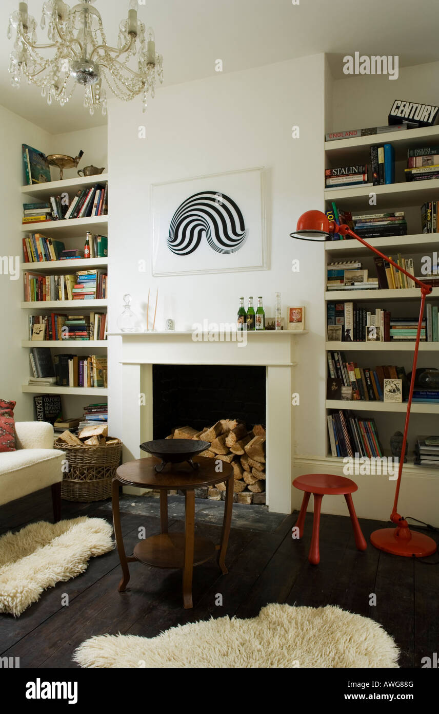 Living room with sheepskin and mantelpiece in London townhouse - Stock Image