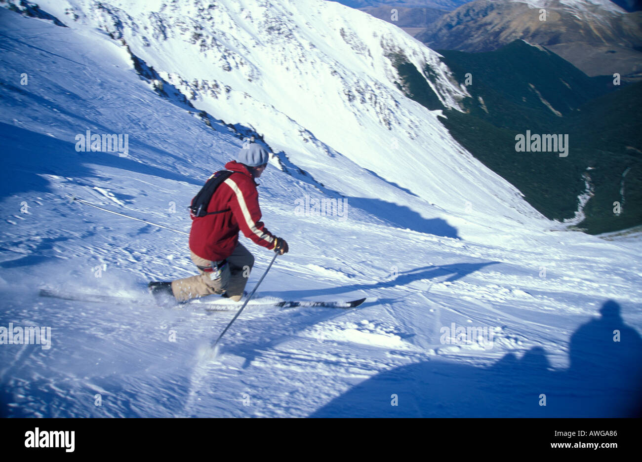 Telemark skier dropping into Middle Basin at Craigieburn Ski Field Canterbury New Zealand - Stock Image