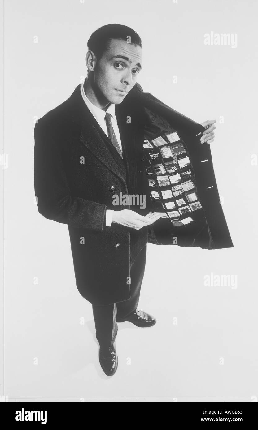 A man holding his jacket open showing many business credit cards Stock Photo