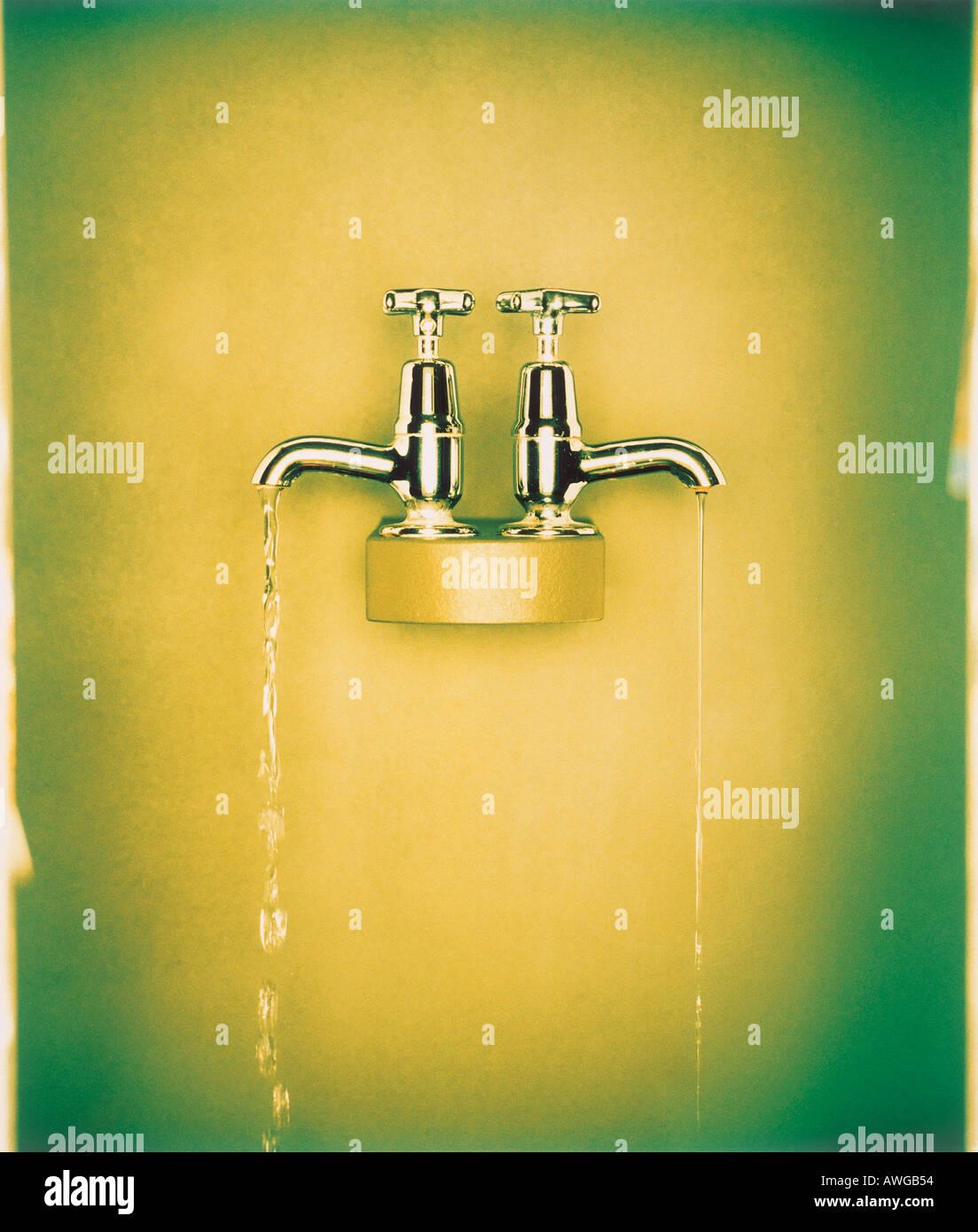 Taps running water - Stock Image