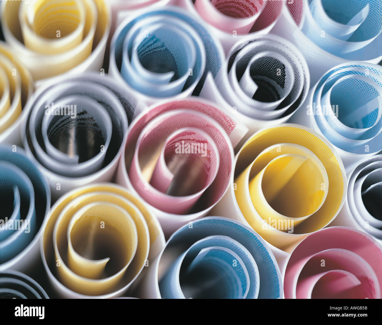 Scrolls of printing papers CMYK - Stock Image