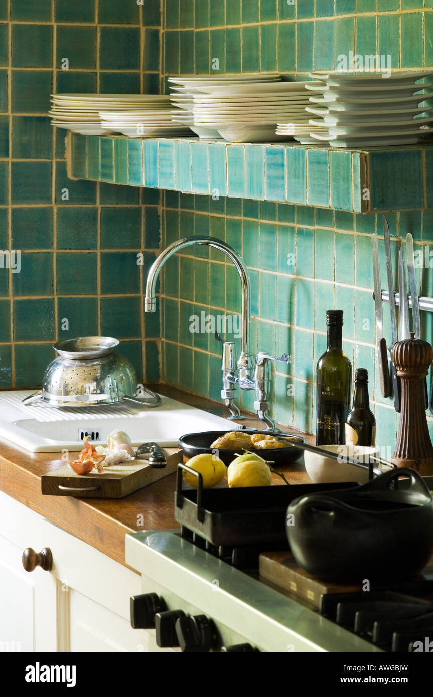 Tiled crockery shelf above sink in kitchen of well known chef - Stock Image