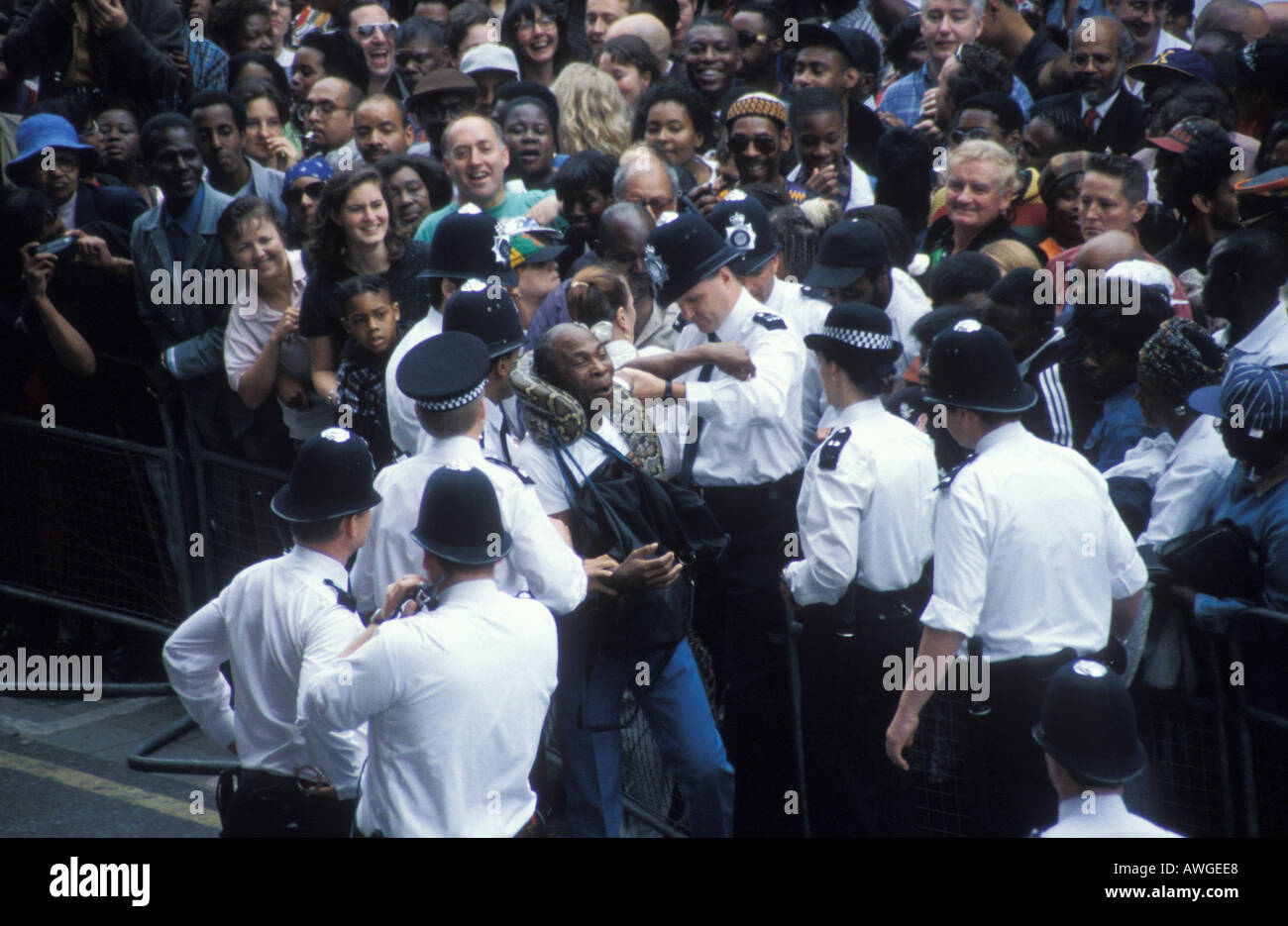 Man with snake in Brixton when Nelson Mandela visited London England Stock Photo