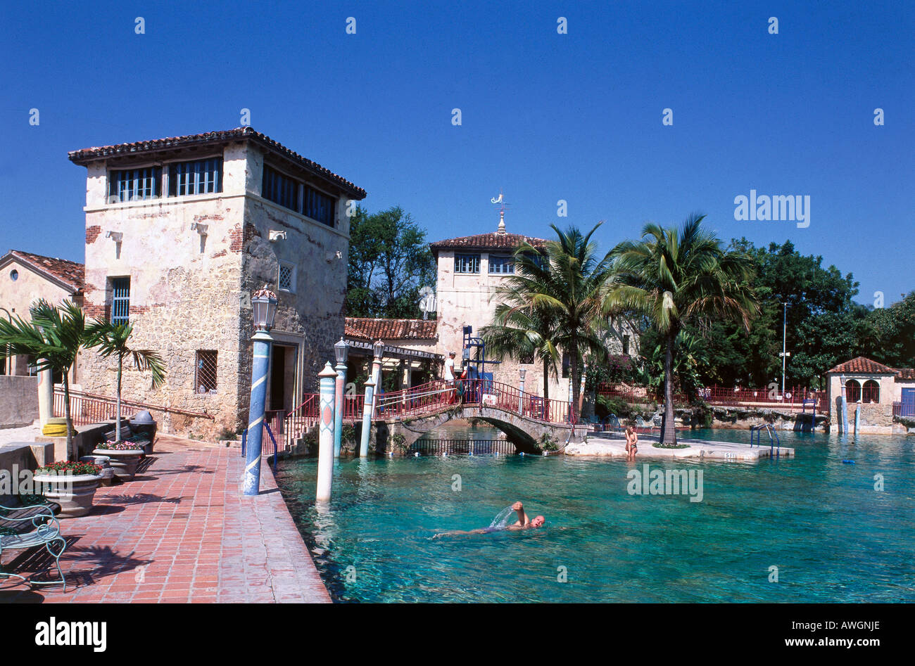 USA, Florida, Miami, Coral Gables, visitor swimming in Venetian Pool - Stock Image