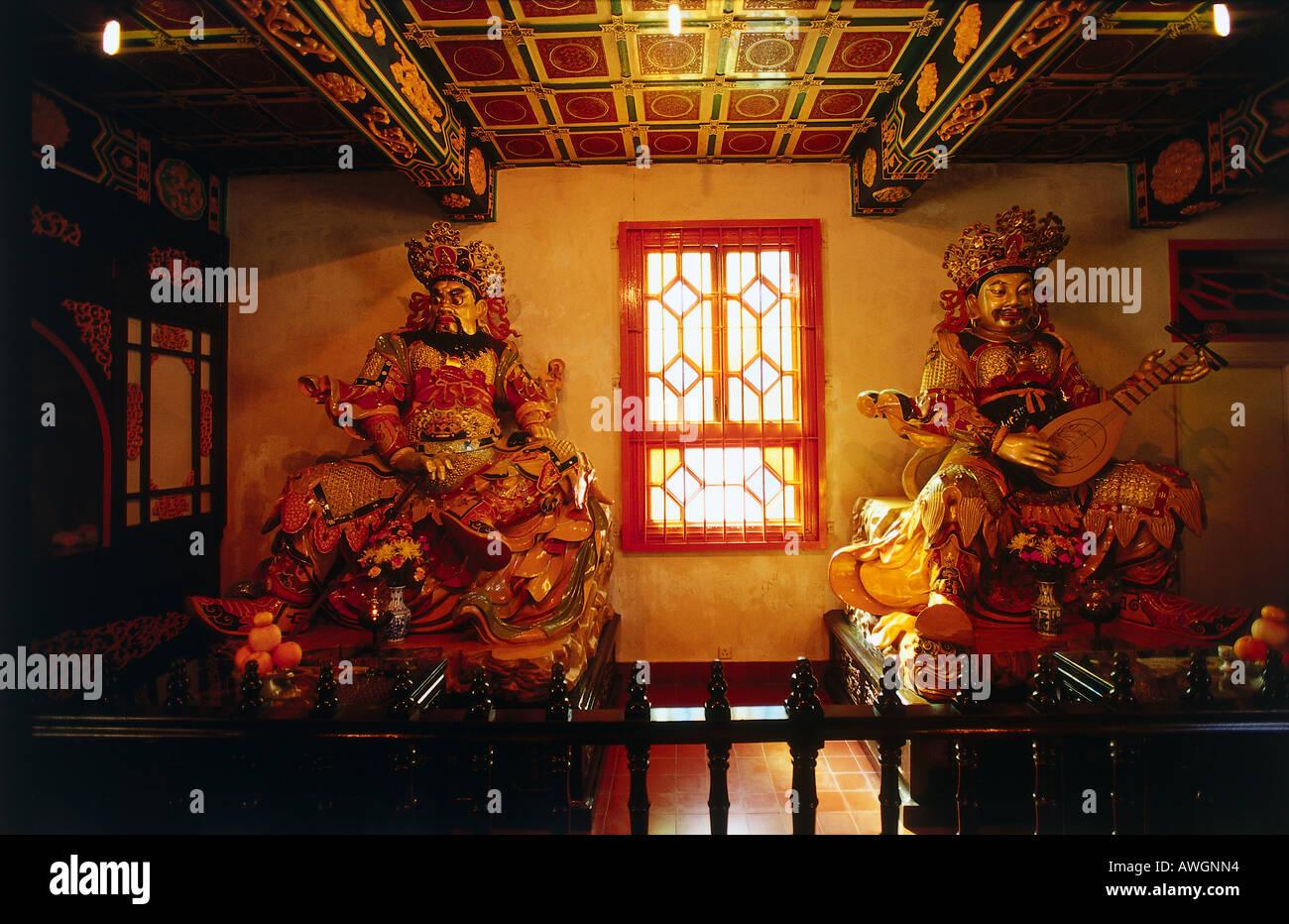 Hong Kong, Big Buddha and Po Lin Monastery, Bodhisattvas - statues of the Buddhist saints, either side of monastery window - Stock Image