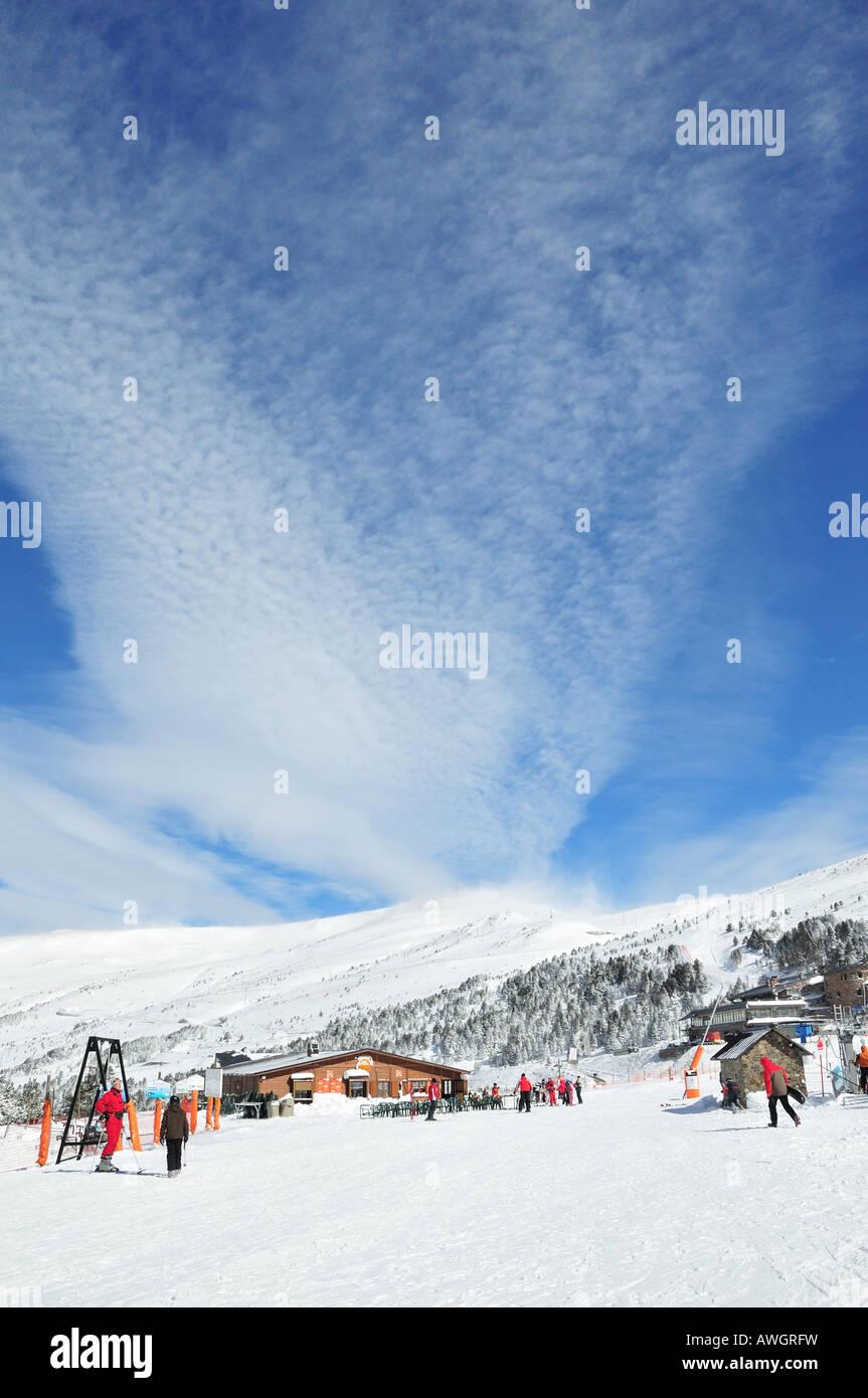 Cirrus clouds forming over the Pyrenees, Grandvalira skiing resort, Andorra (Spain) - Stock Image