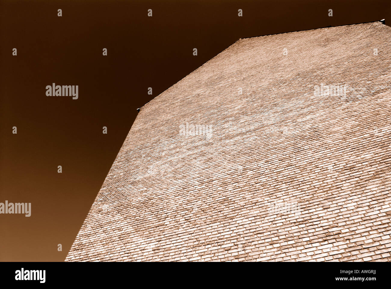 SEPIA BRICK WALL - Stock Image