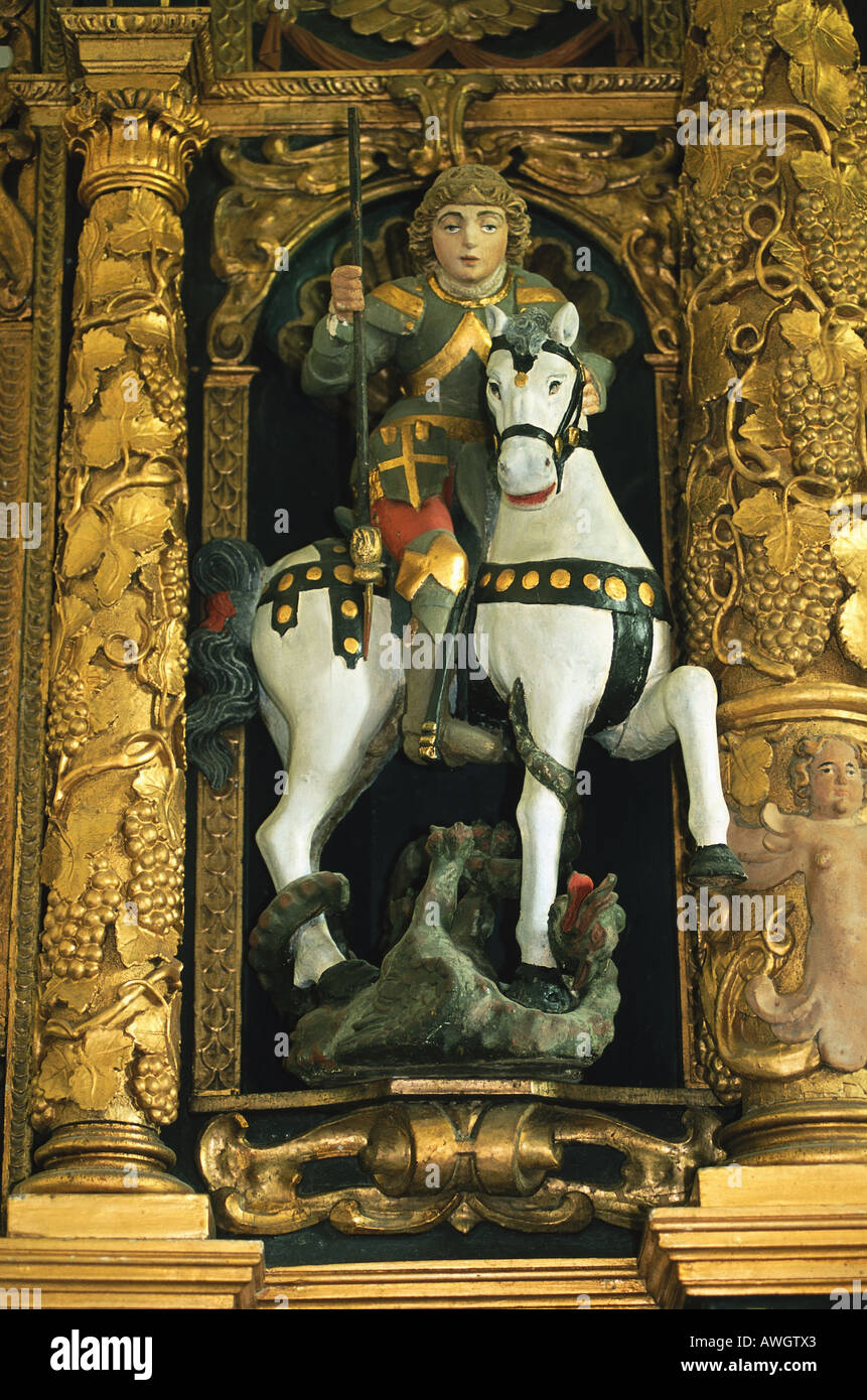 Croatia, Istria, Plomin, St George the Younger, part of carved, painted wood Renaissance altar depicting man on horseback - Stock Image