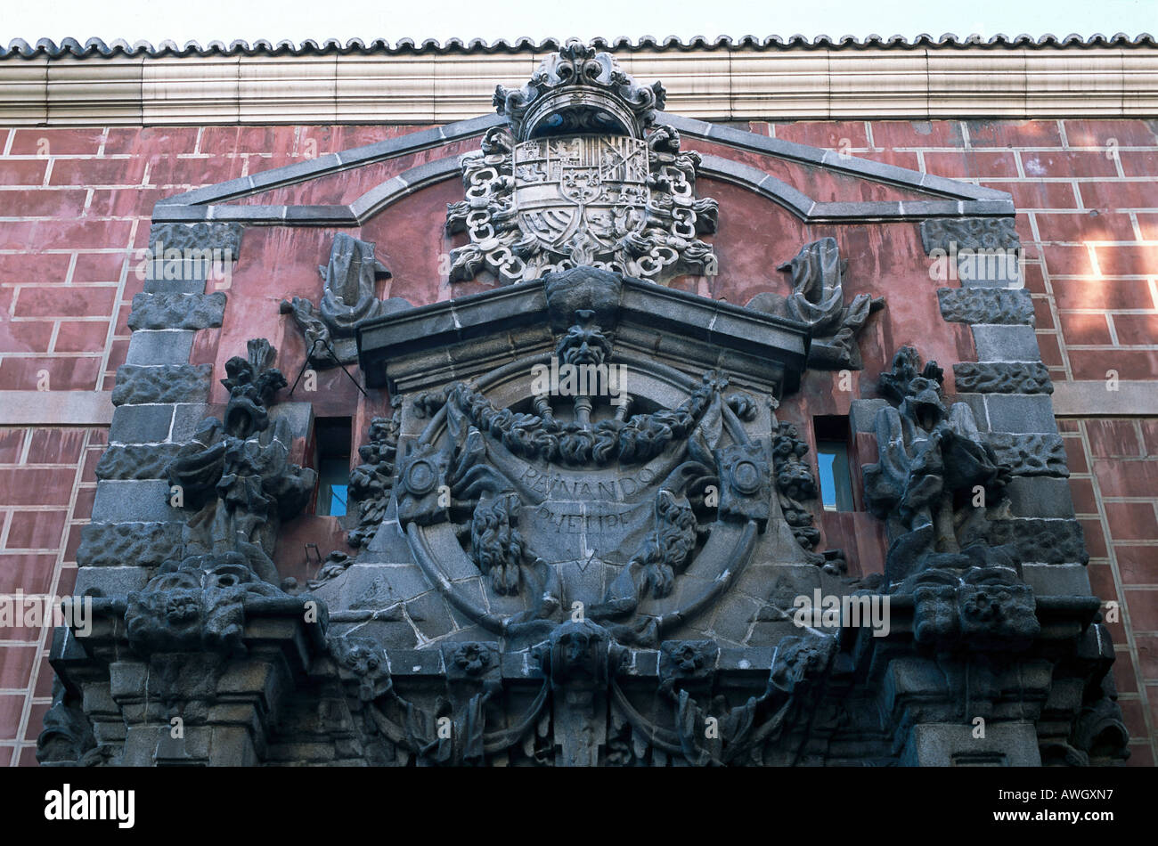 Spain, Madrid, Calle de Conde Duque 11, Centro Cultural Conde Duque, carved stonework on upper façade of 1920s cinema, - Stock Image