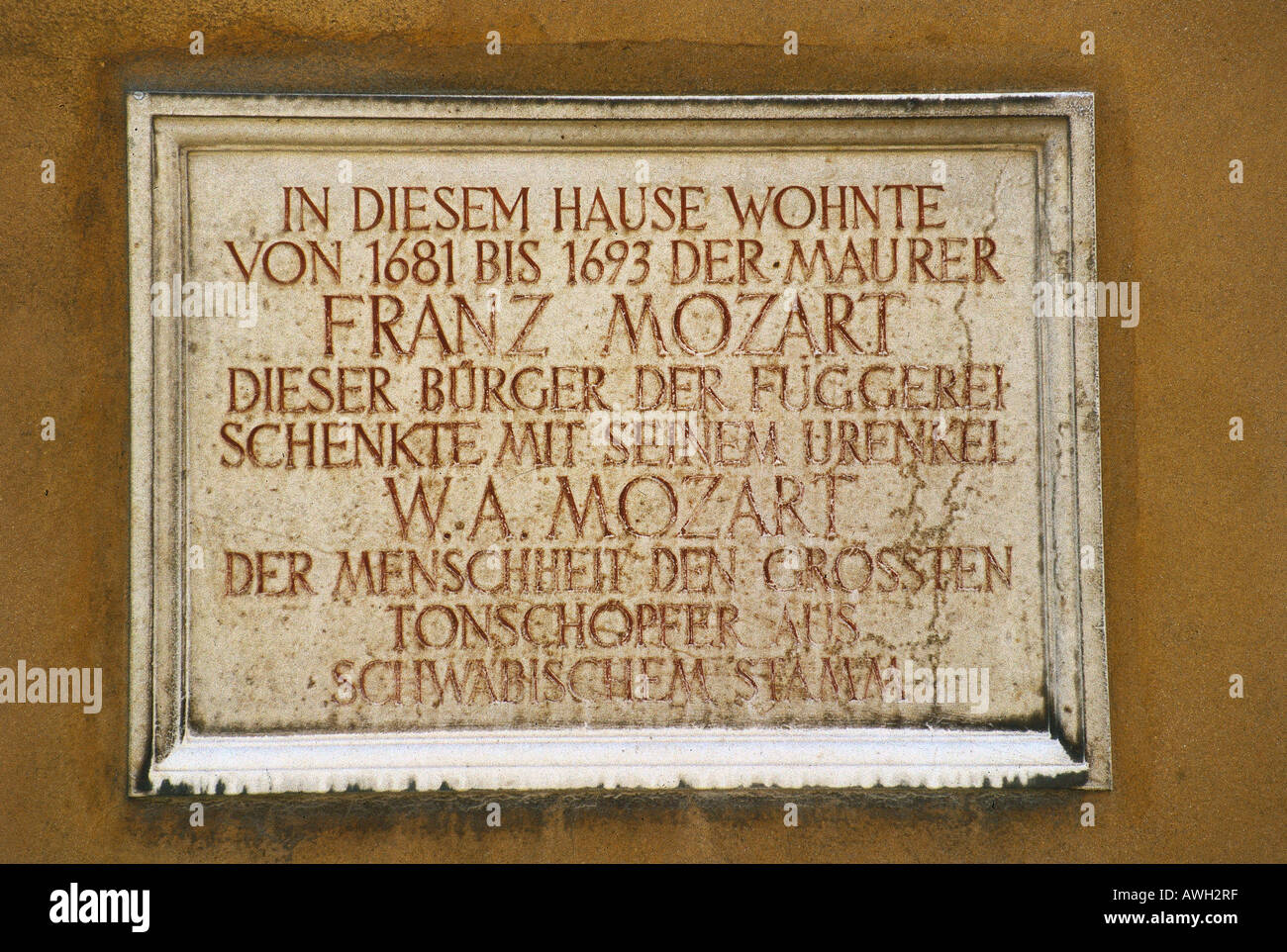 Germany, Bavaria, Northern Swabia, Augsburg, memorial plaque to Franz Mozart, one-time resident of the Fuggerei - Stock Image