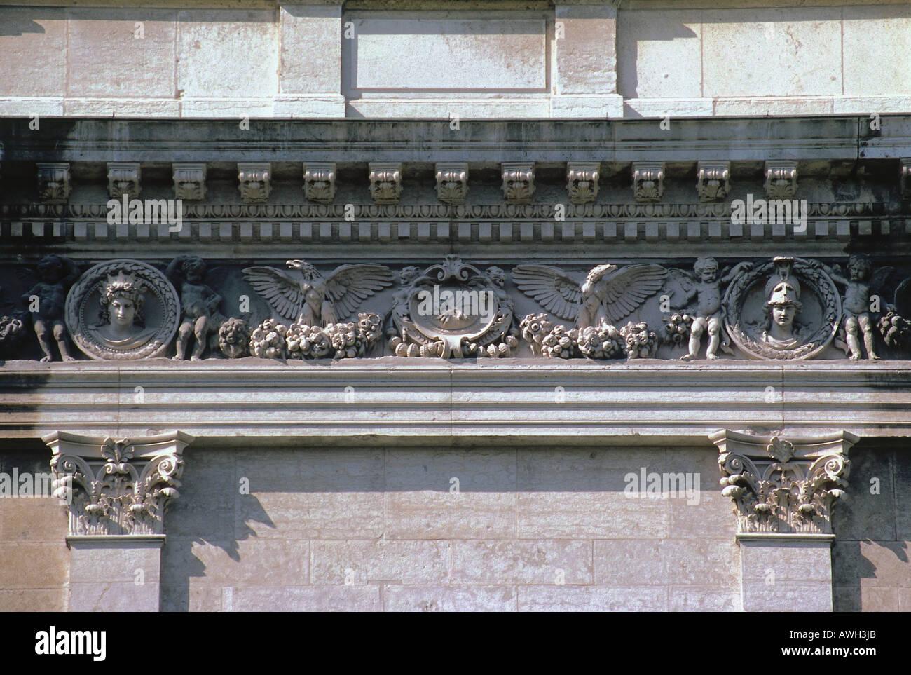 Germany, Bavaria, Munich, Akademie der Bildenden Künste, highly ornamented terracotta frieze on window - Stock Image