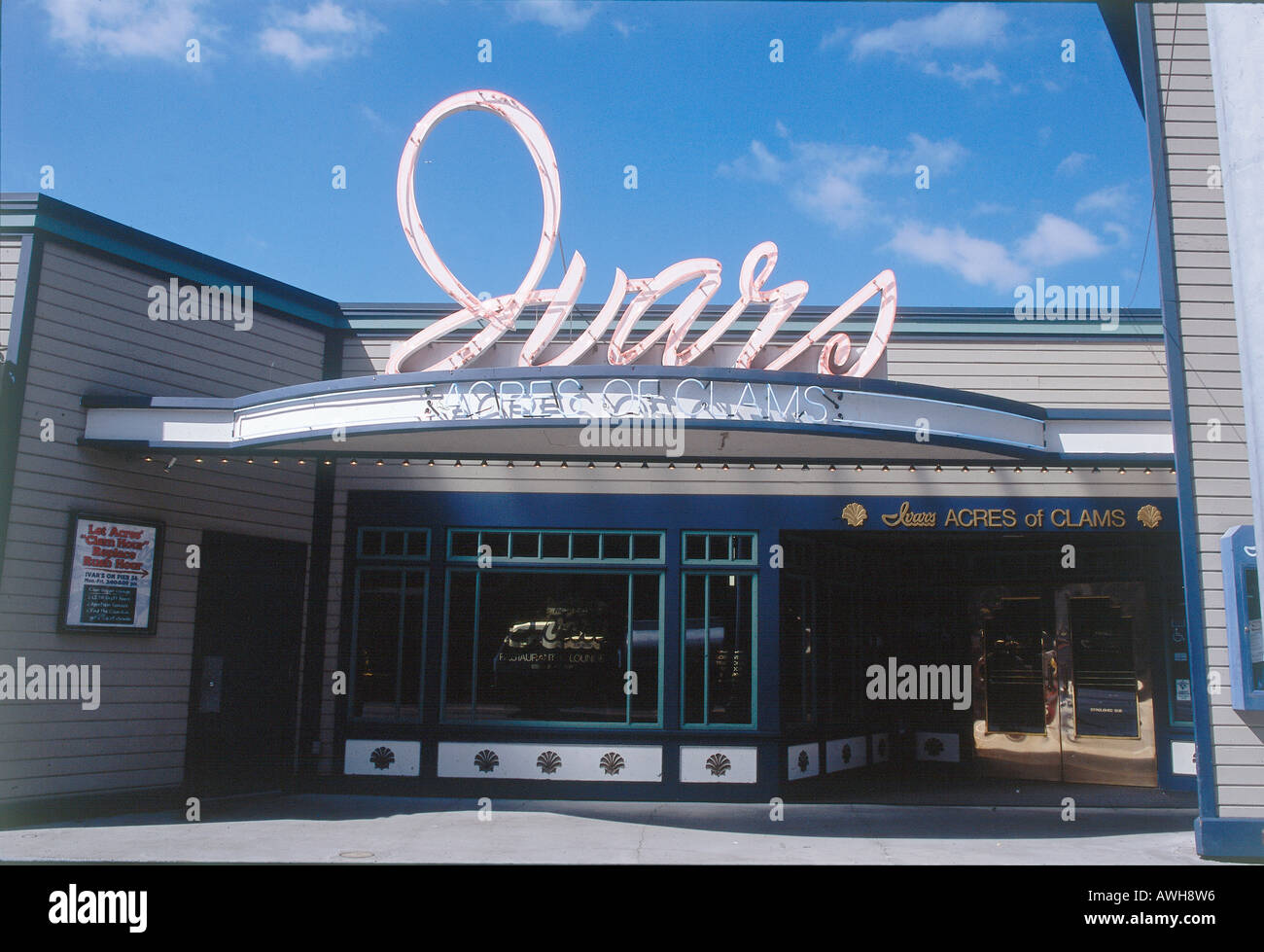 USA, Pacific Northwest, Washington State, Seattle, Ivar's Acres of Clams, unlit neon sign on roof above façade and entrance - Stock Image