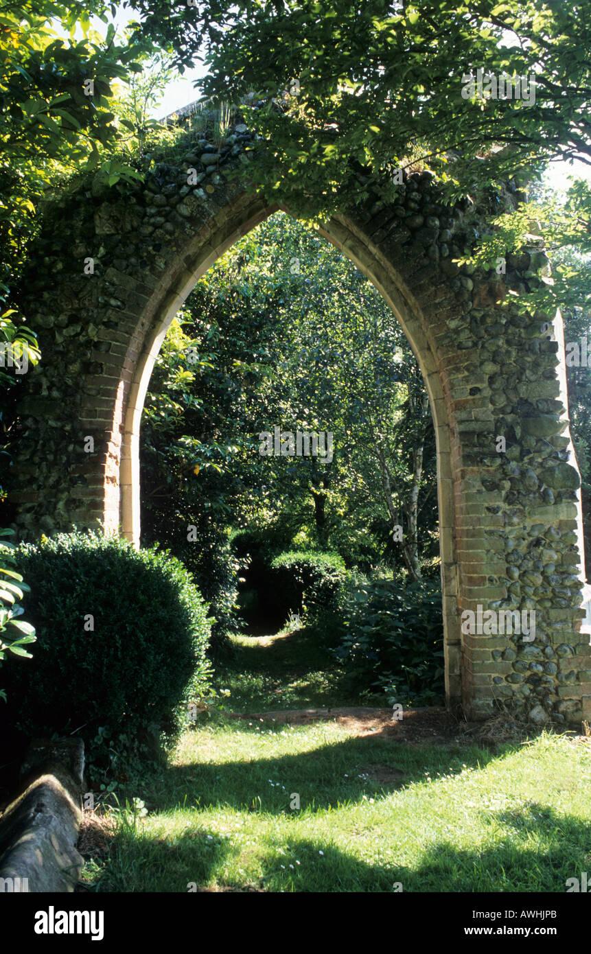 Gothic ruin in wild natural garden setting Mannington Hall garden Norfolk - Stock Image
