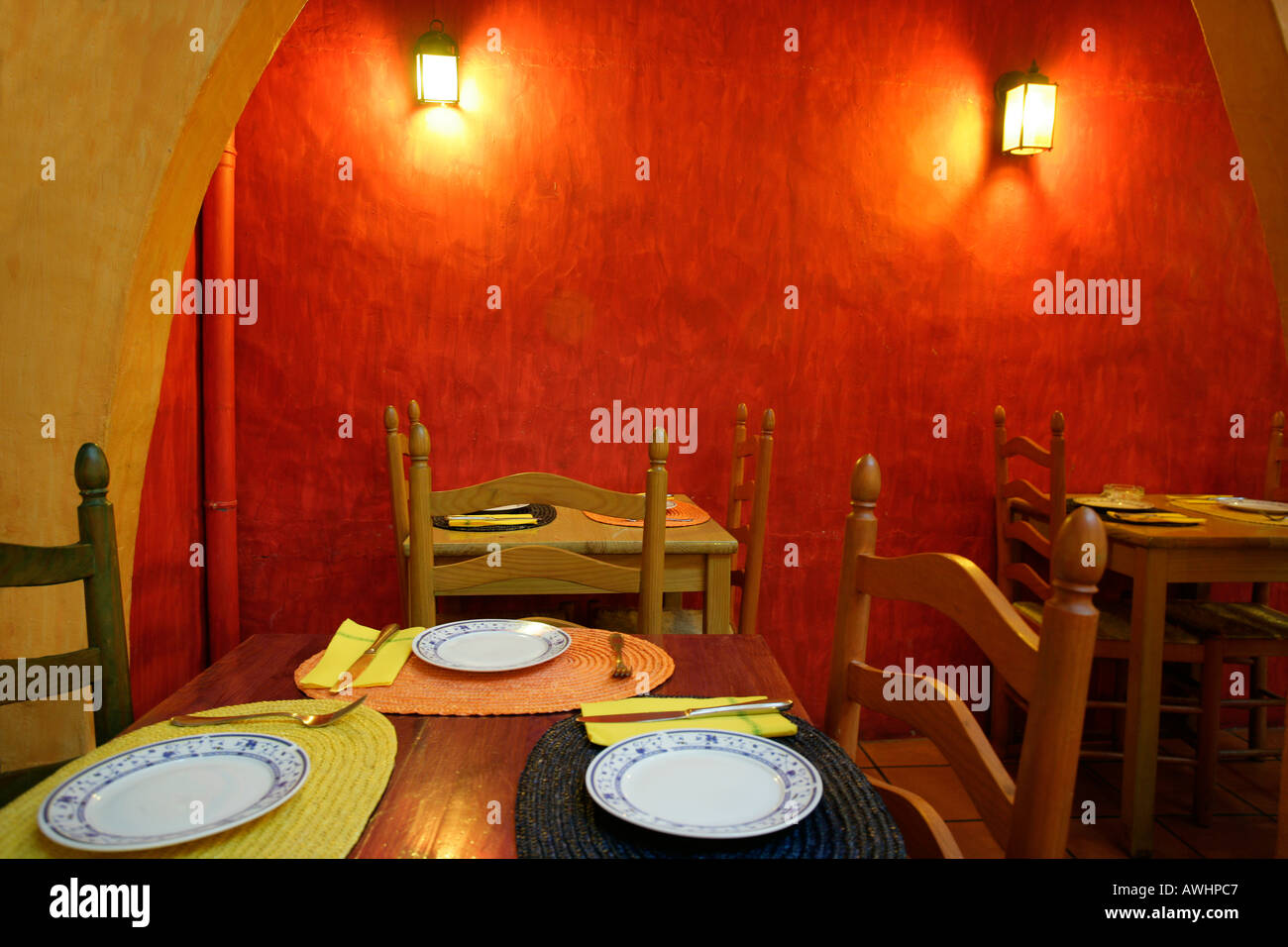 The rustic interior of a restaurant painted in bright warm colors ...