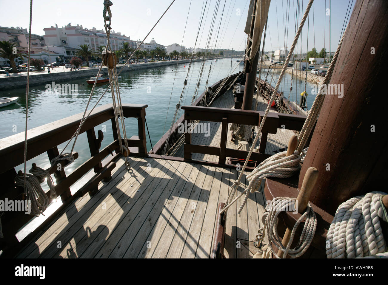 A view of the main canal through Lagos Portugal from the deck of a reproduction caravel sailing ship - Stock Image