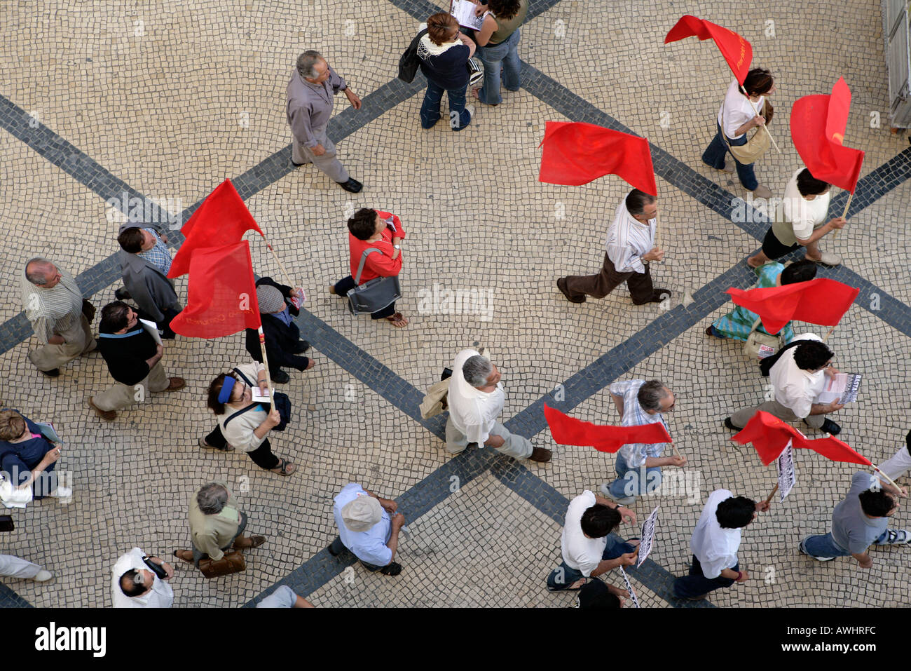 The Communist Part of Portugal stages a rally with their red flags and marches down Rua Augusta on their way to - Stock Image