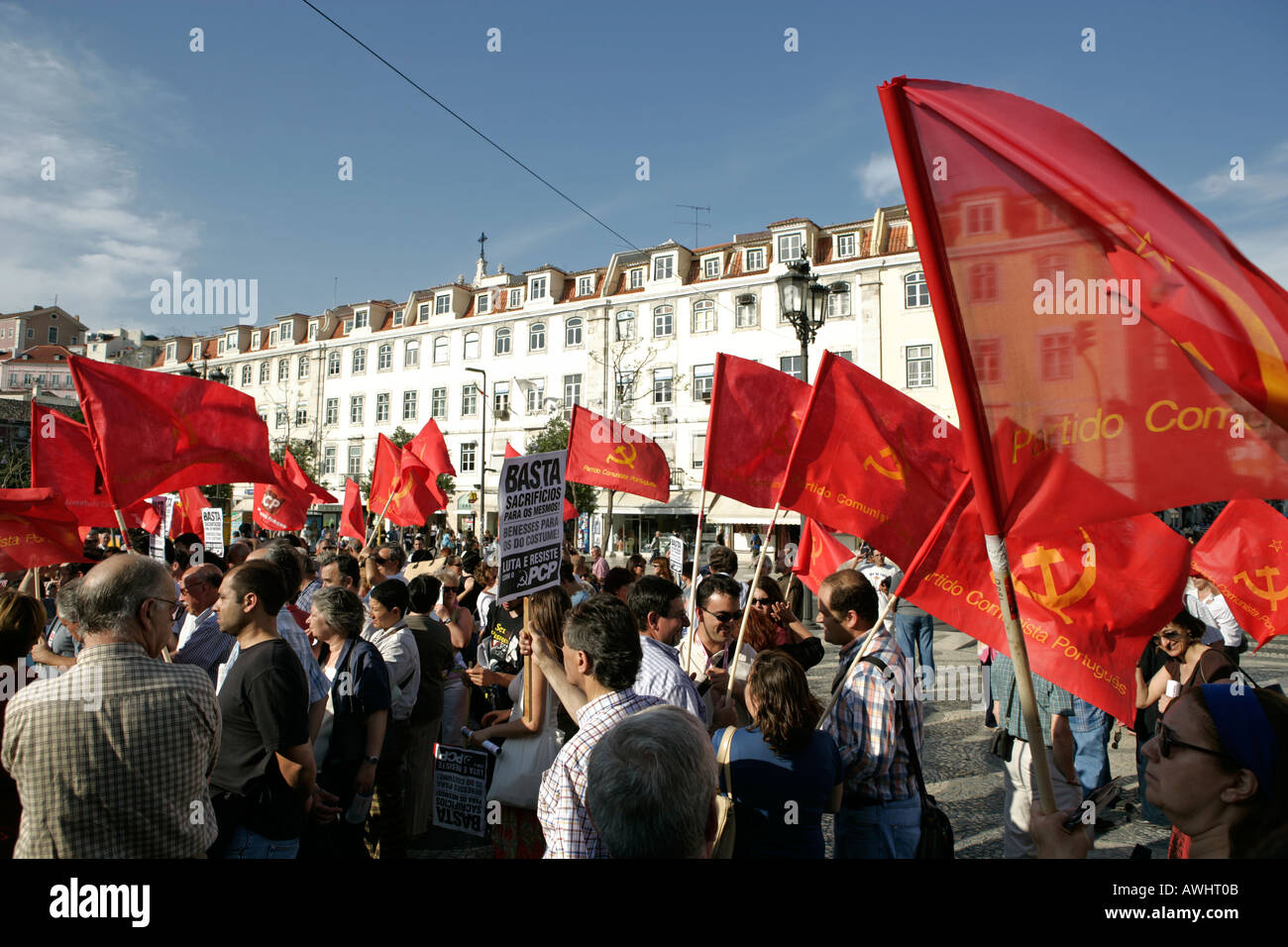 The Communist Part of Portugal stages a rally with their red flags and marches into Rossio Square for speeches - Stock Image