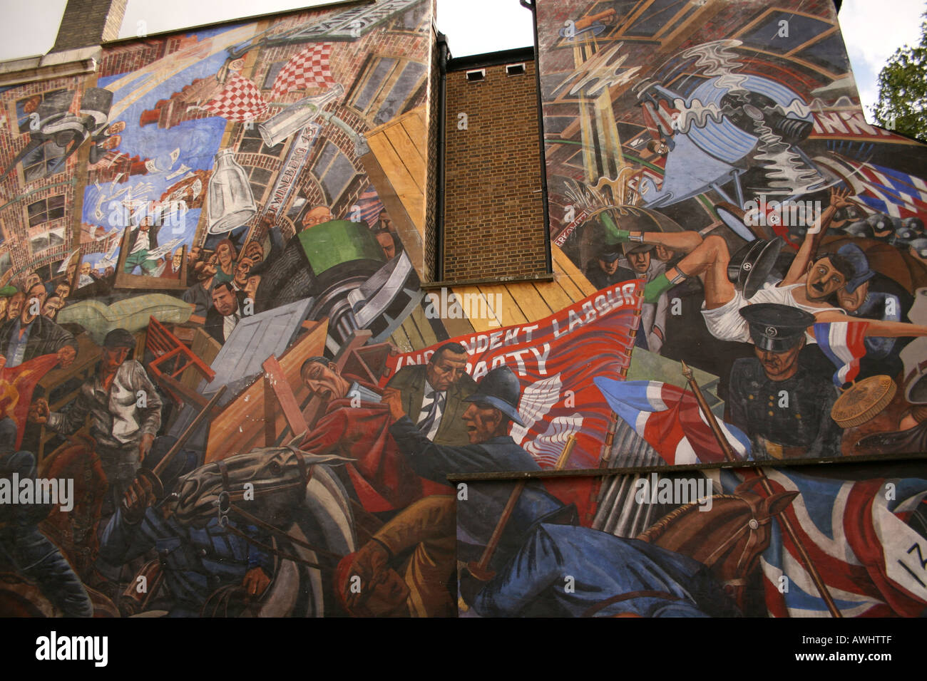 A wall mural in Cable Street London marking the battle between The British Union of Fascists led by Oswald Mosley and the local - Stock Image
