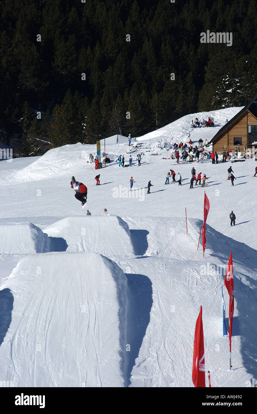 snowboarding jumping snowboard park soldeu ski resort andorra stock