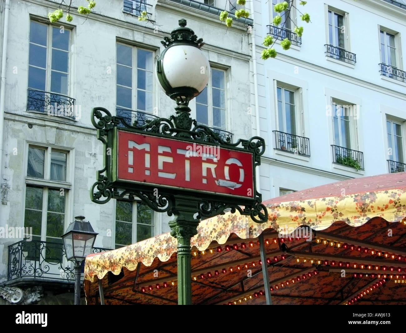 Art Nouveau Metro sign with light outside a Metro station in Paris ...