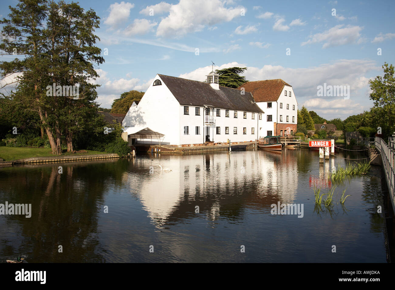 Hambleden Mill with weather vain on wier near Henley on Thames on River Thames - Stock Image
