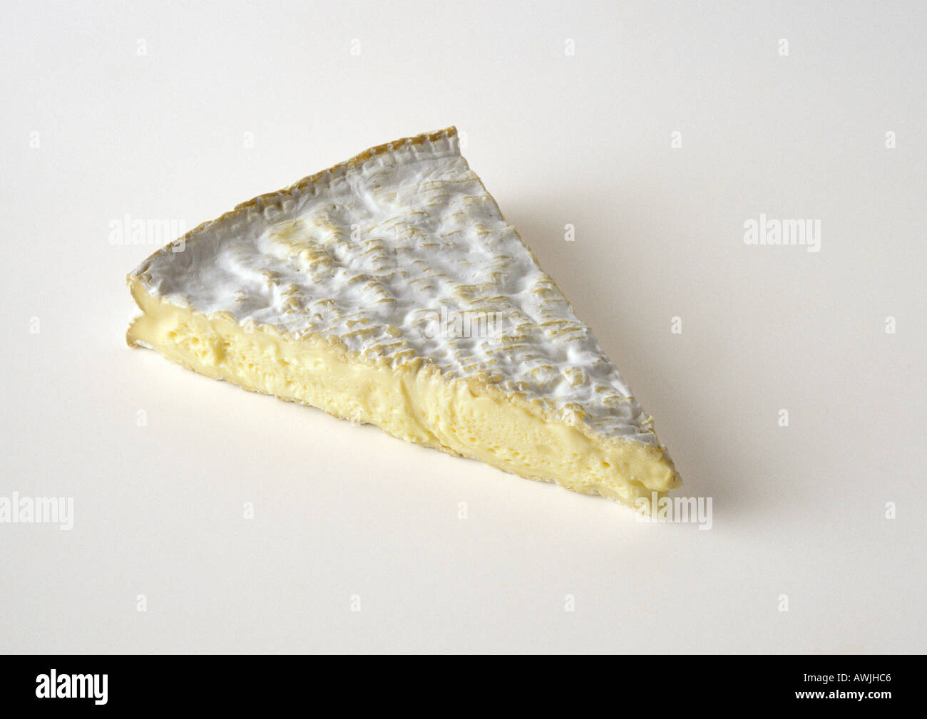 Slice of Brie cheese - Stock Image