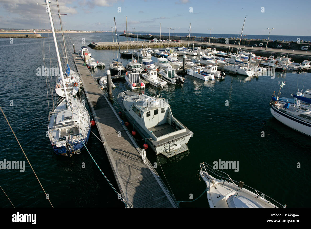 Sailboats and power boats tied up at the pleasure boat marina at Peniche Portugal - Stock Image
