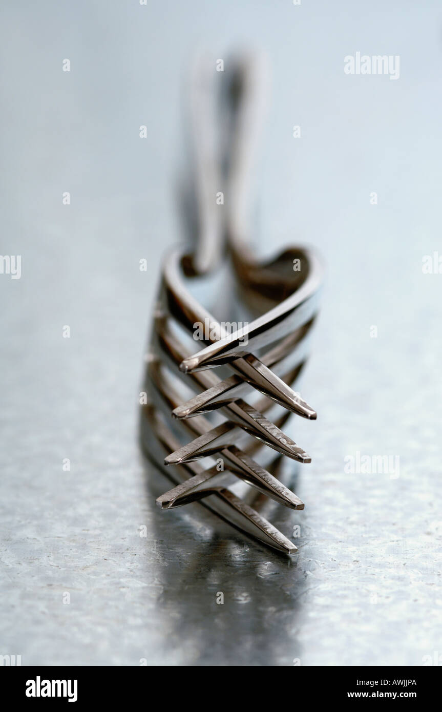 2 intertwined forks - Stock Image