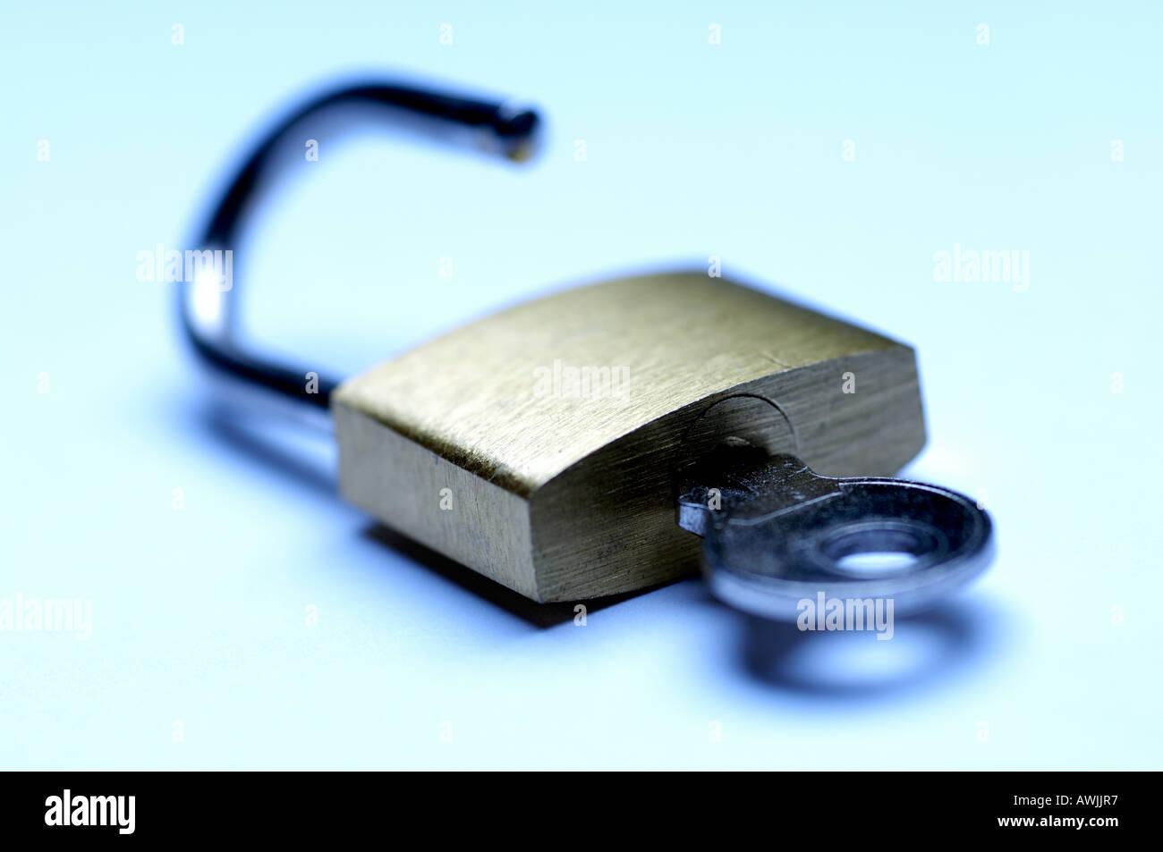 Open padlock and key - Stock Image