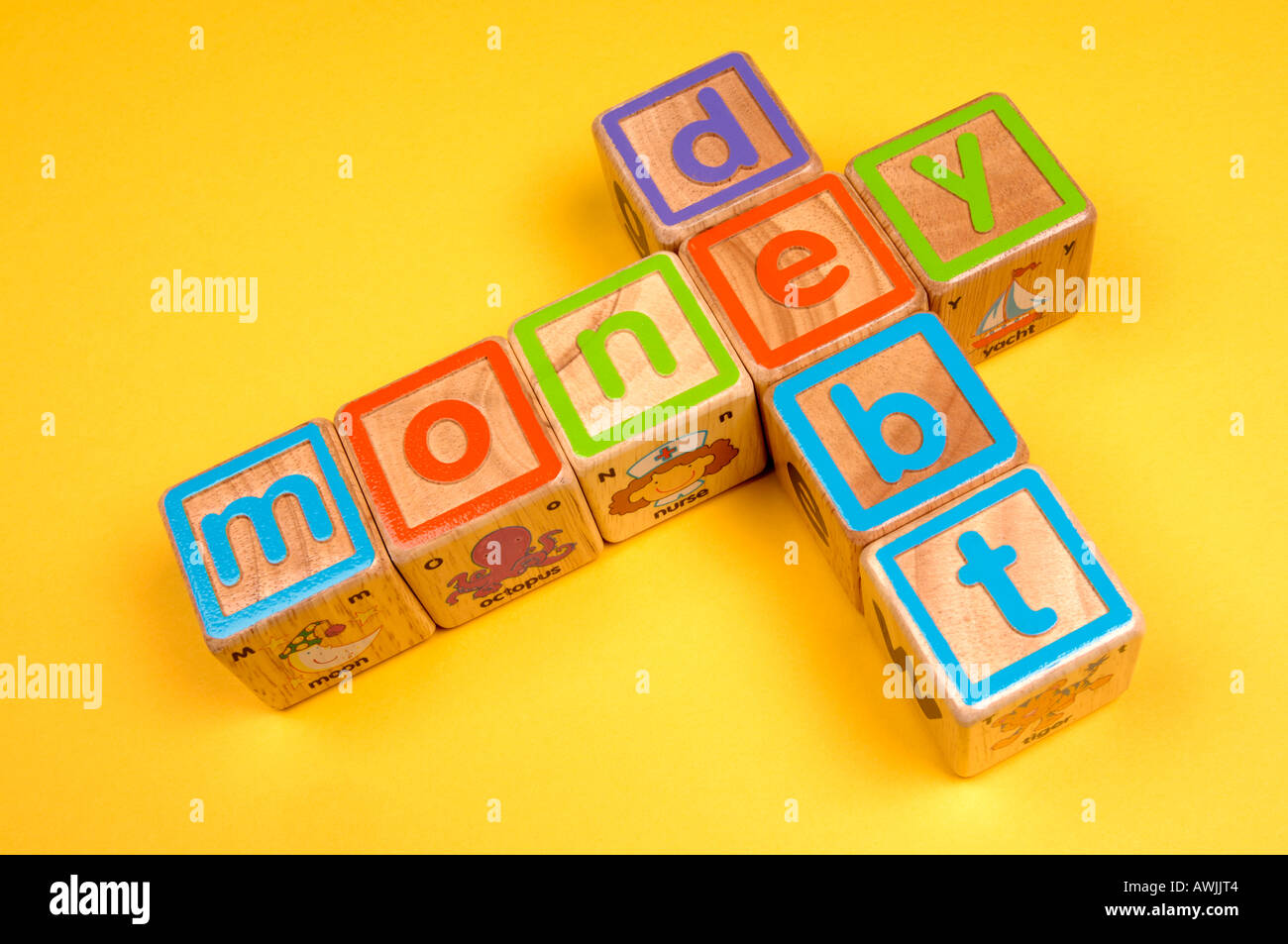 Wooden blocks depicting money linked to debt - Stock Image