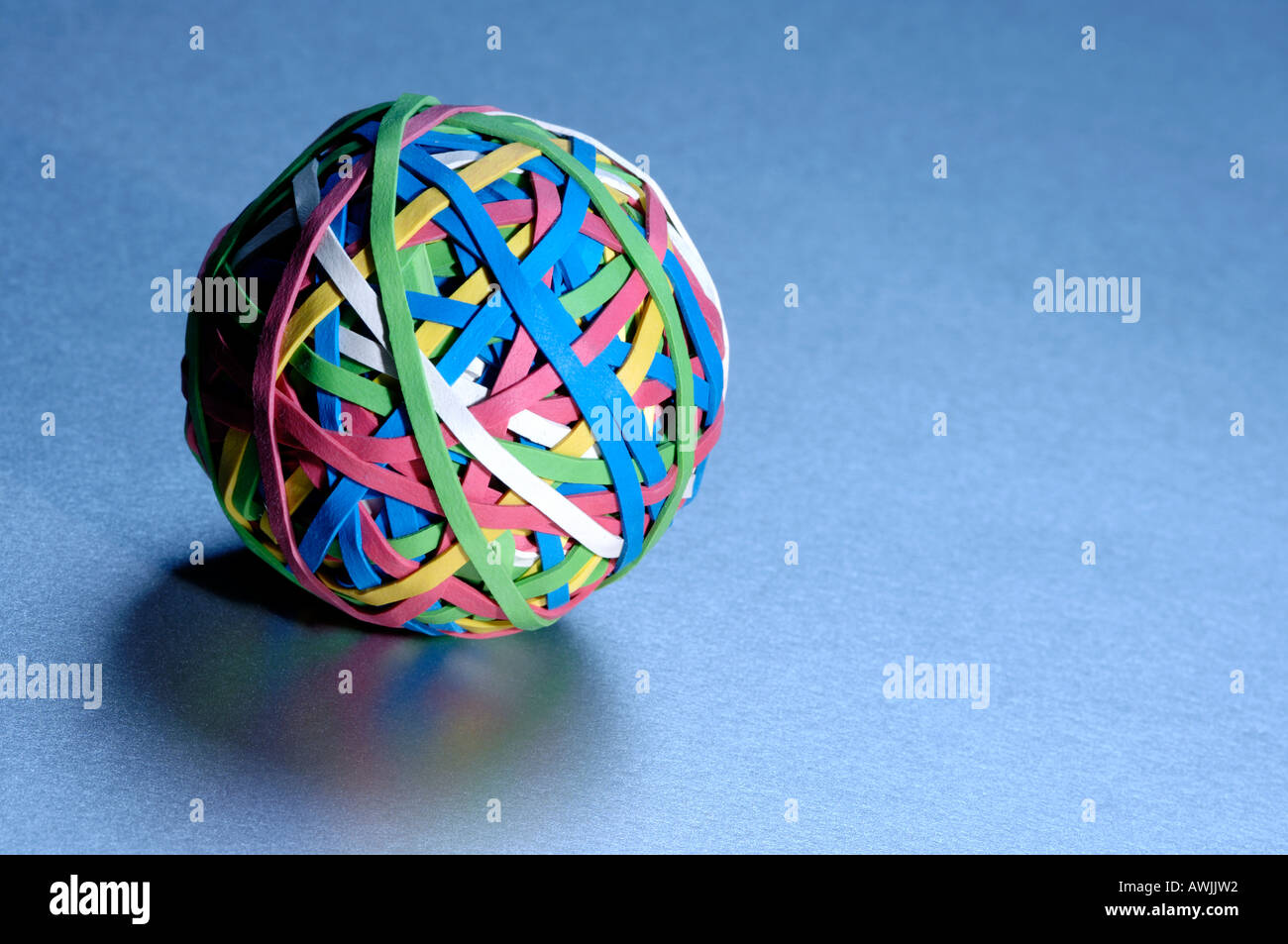 Ball of coloured rubber bands - Stock Image