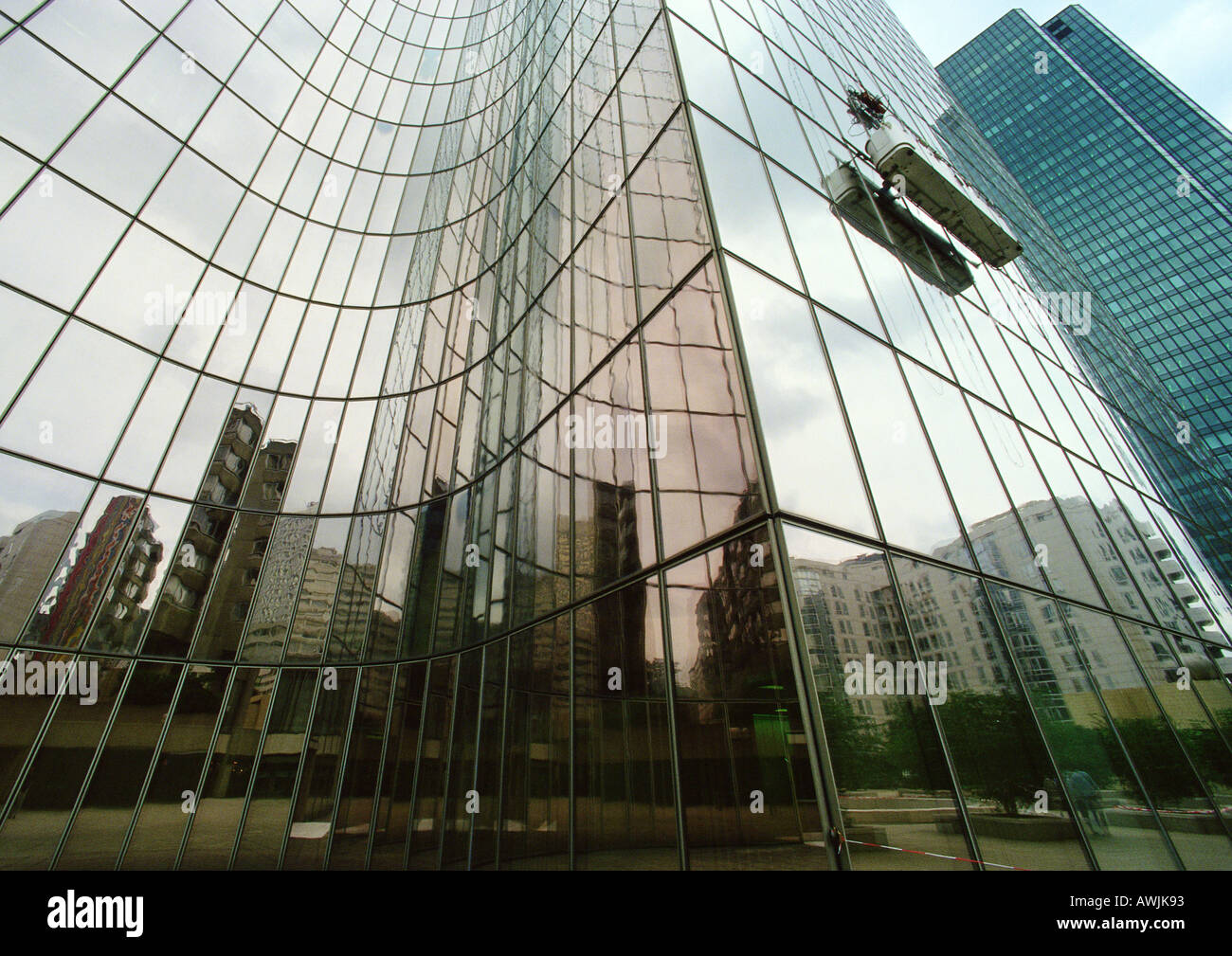 France, Paris, buildings reflected in glass facade of skyscraper - Stock Image
