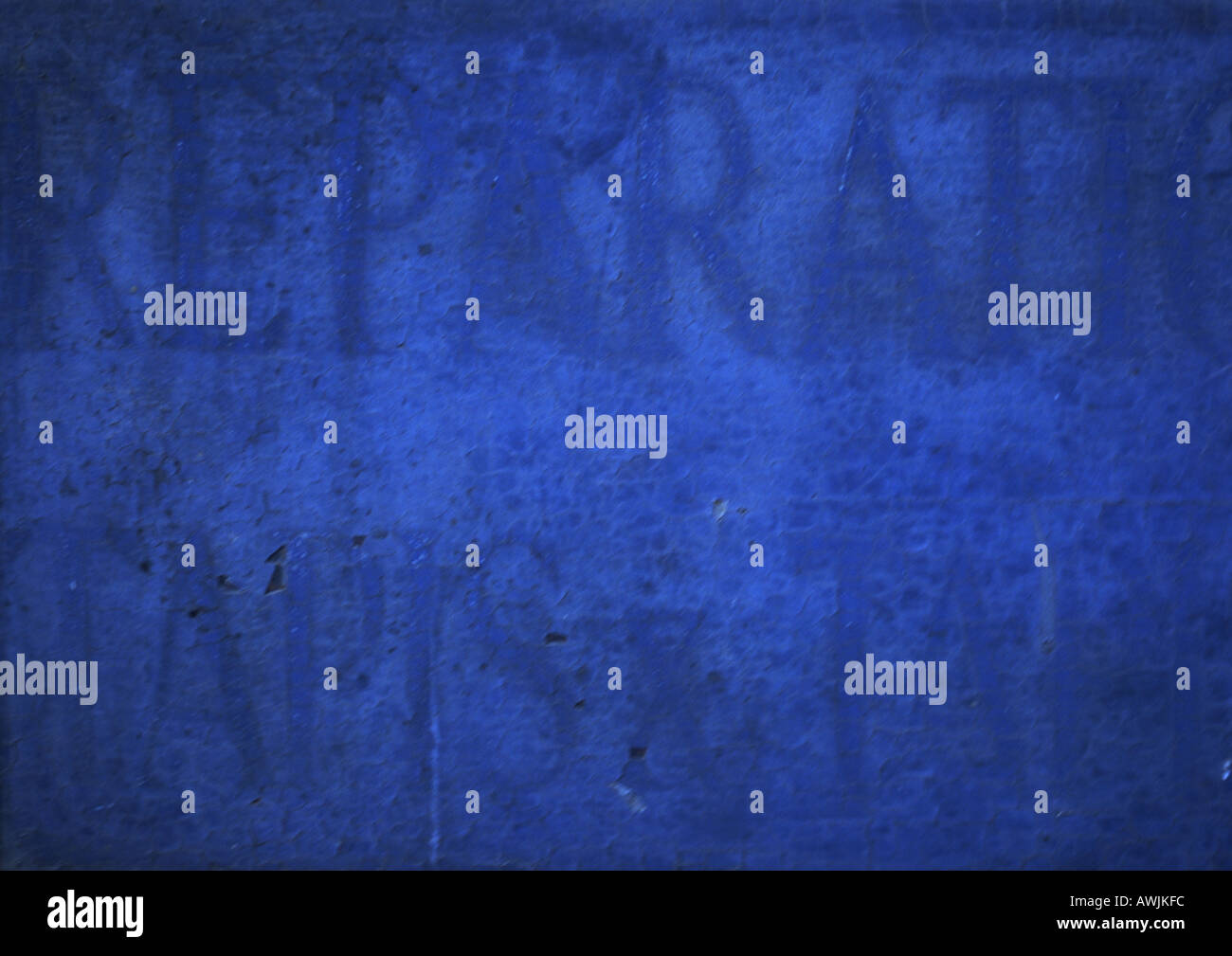 Blue typography on blue surface. - Stock Image