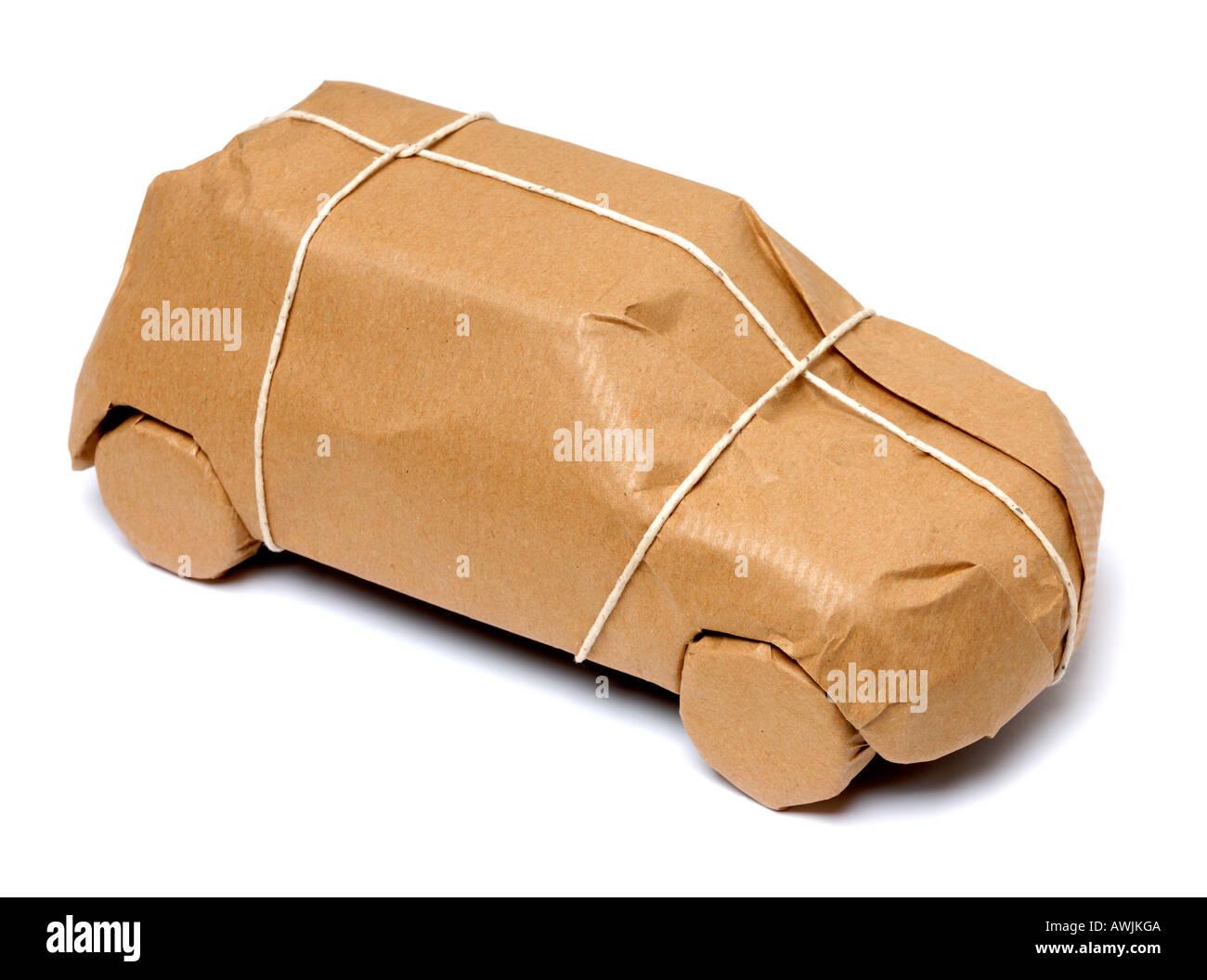 Car shaped paper parcel - Stock Image