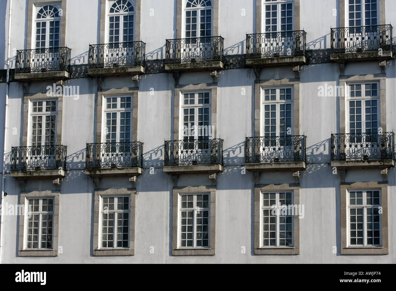 A Detail Shot Of A Classical Building With Multiple Windows French