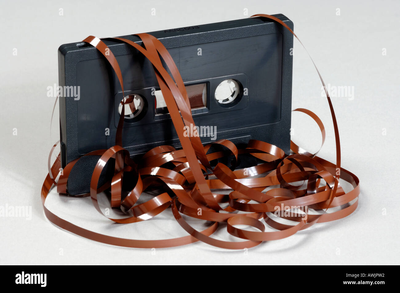 Audio cassette with tape spilling out - Stock Image