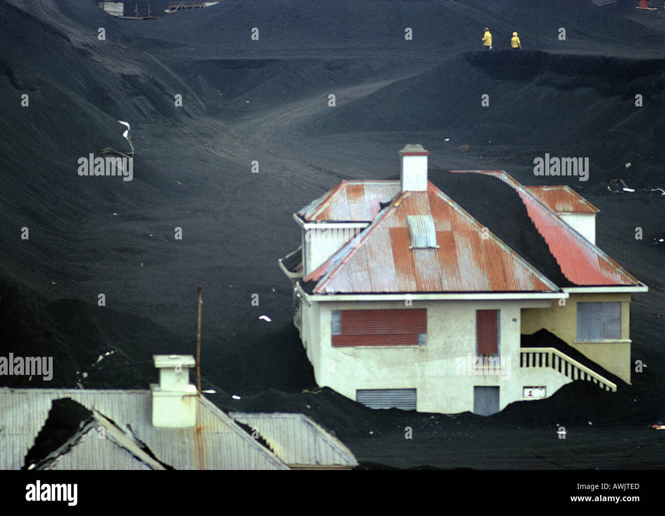 Iceland, houses half buried in volcanic ash - Stock Image