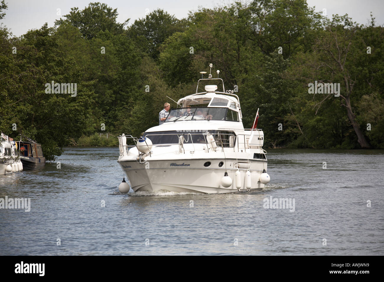 Cabin cruiser motor yacht pleasure boat moored near Medmenham on River Thames between Buckinghamshire and Berkshire Stock Photo