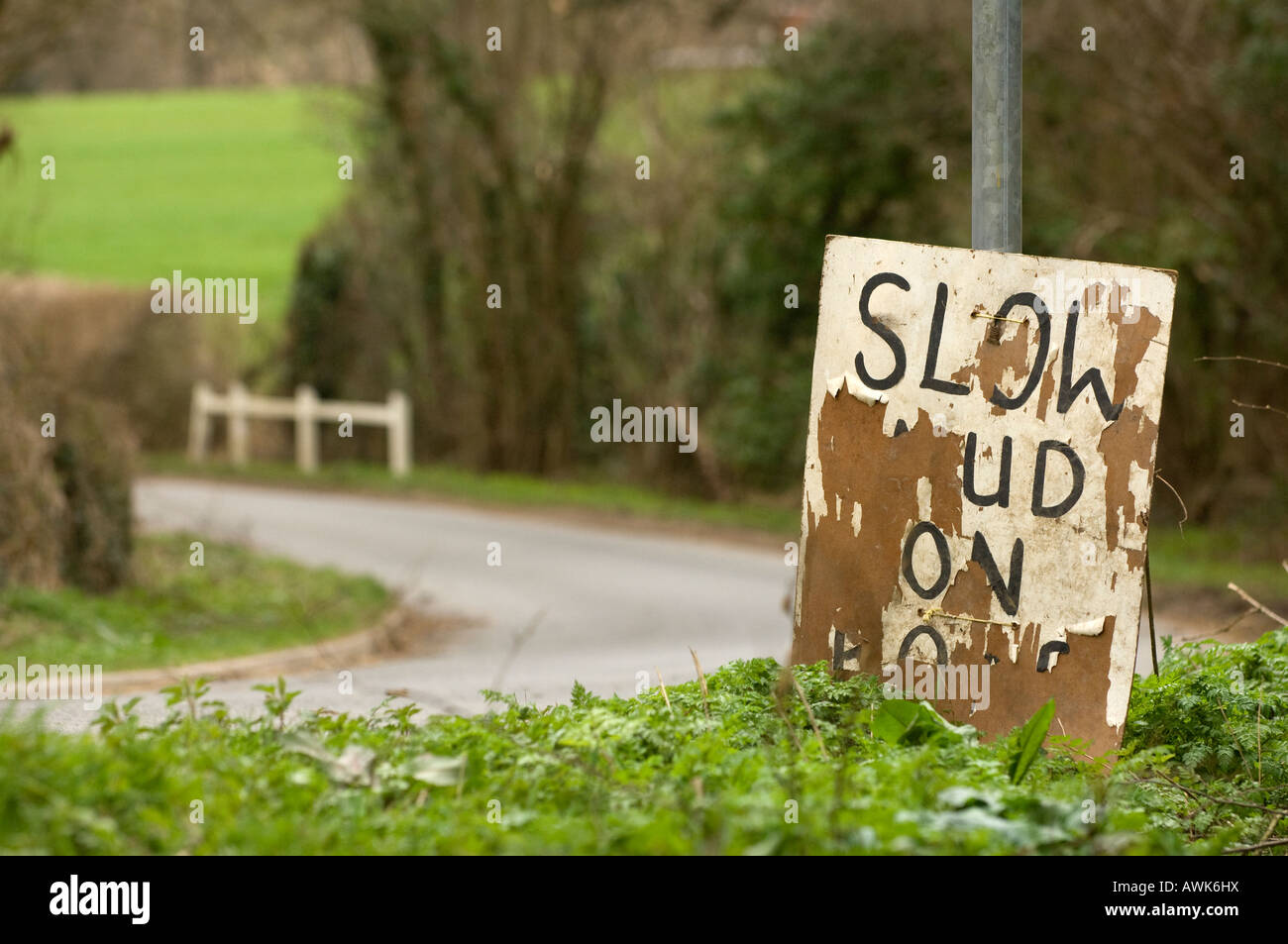 Mud on road sign beside a country lane warning motorists of danger. Picture by Jim Holden. Stock Photo