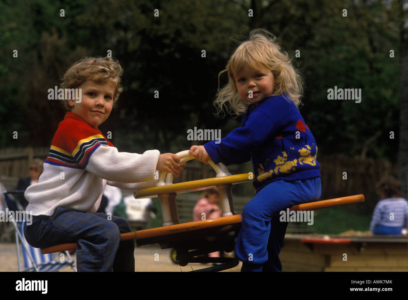 young children on see saw in playground Stock Photo
