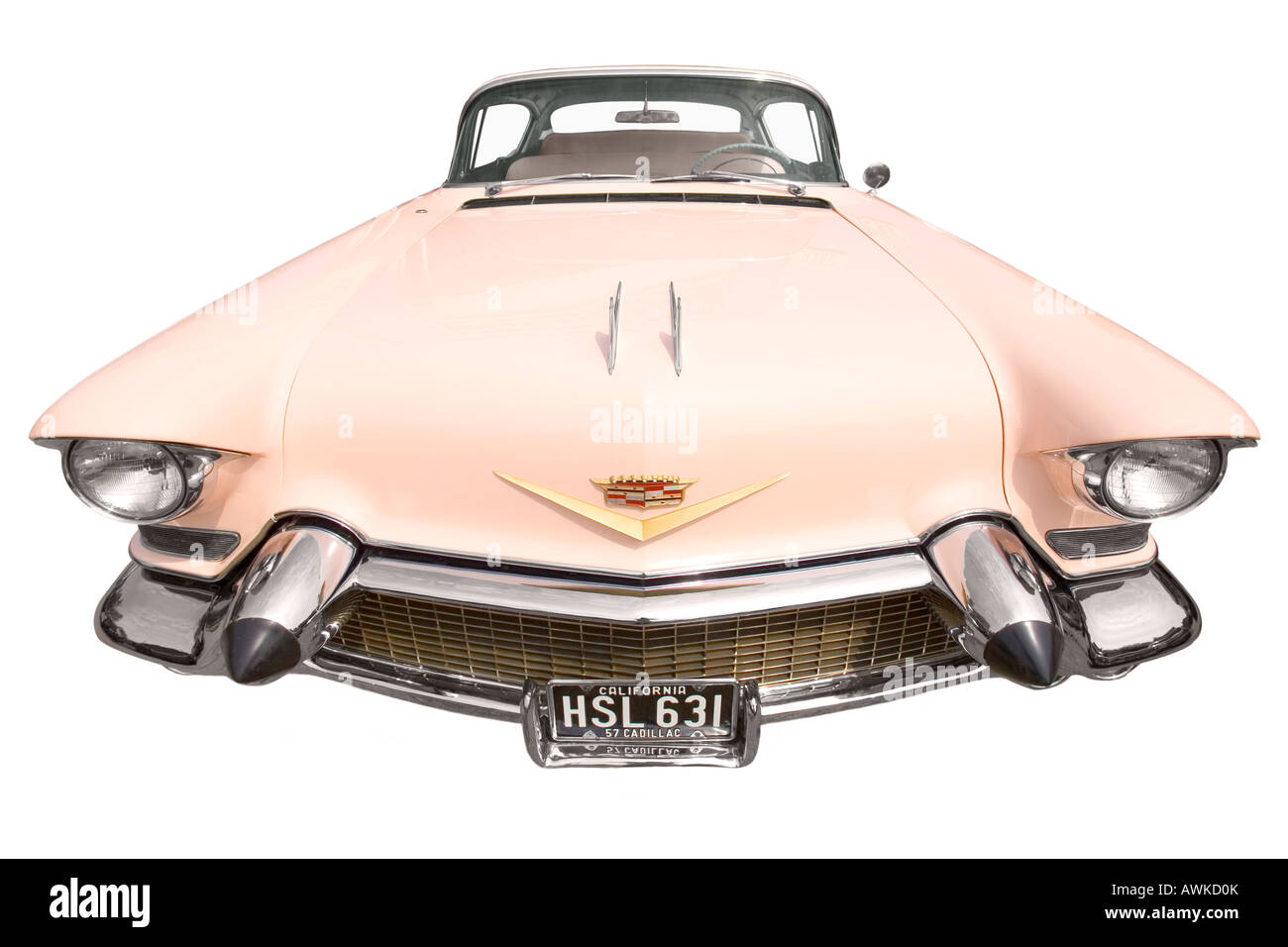 Close focus wide angle view of a retro pink Cadillac on a pure white background. - Stock Image