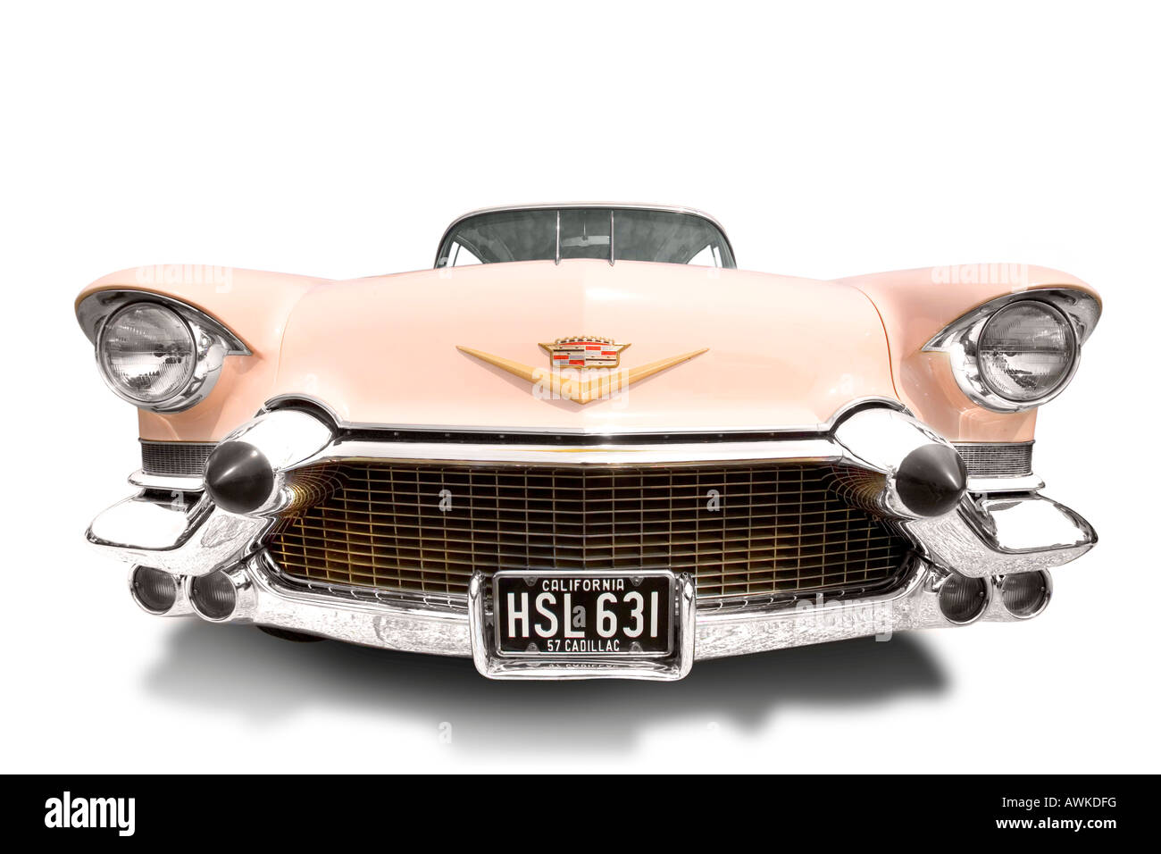 Close focus wide angle front view of a retro pink Cadillac on a pure white background. Stock Photo