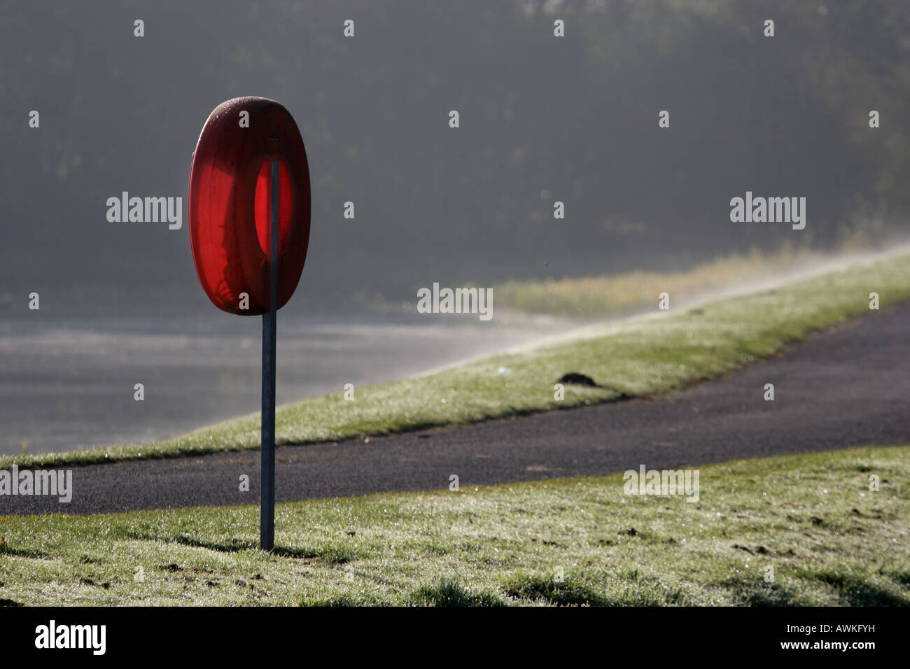 Empty backlit lifebuoy housing at Gartmorn Dam Country Park and Nature Reserve. - Stock Image