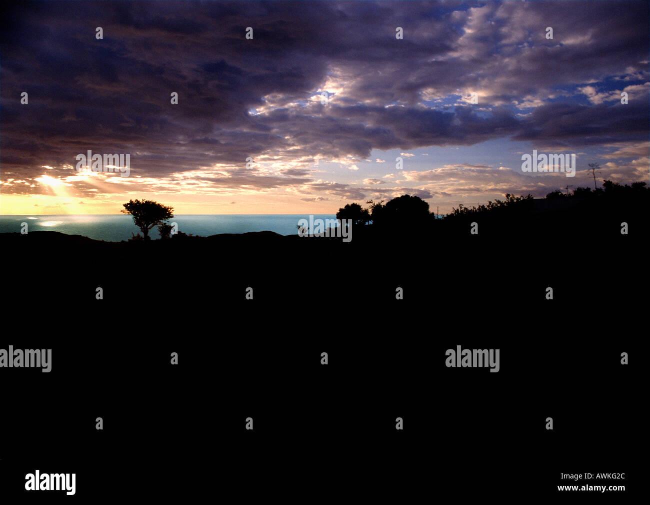 Coastal landscape at sunset - Stock Image