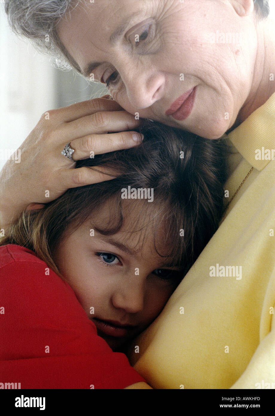 Senior hugging girl - Stock Image