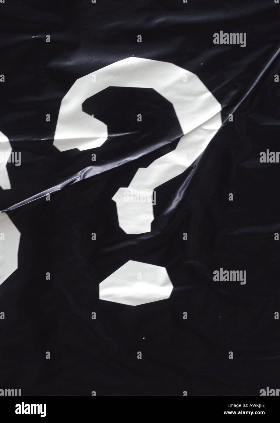 ? text, printed in white on wrinkled black surface - Stock Image