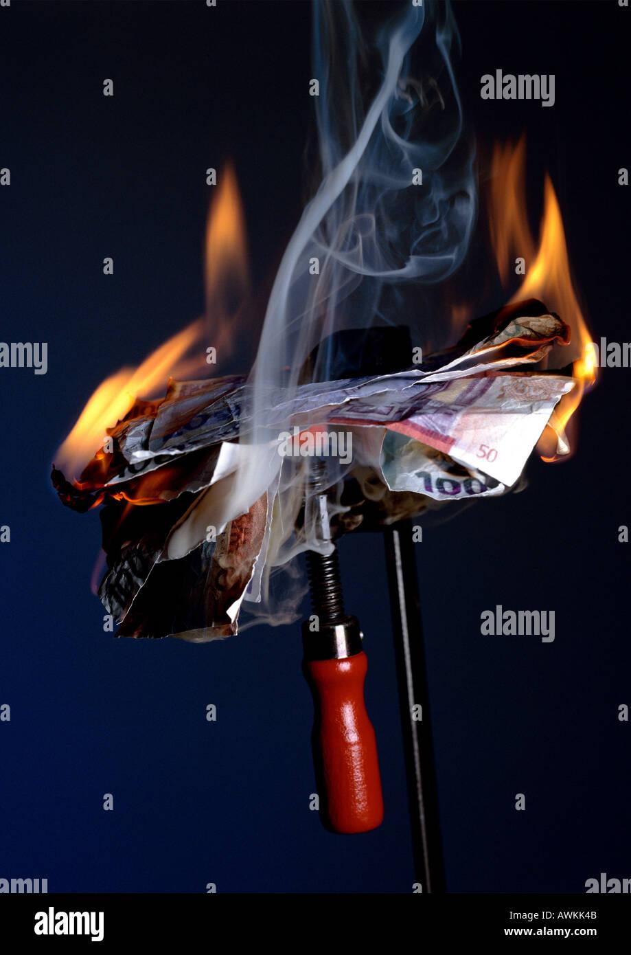 Burning money. - Stock Image
