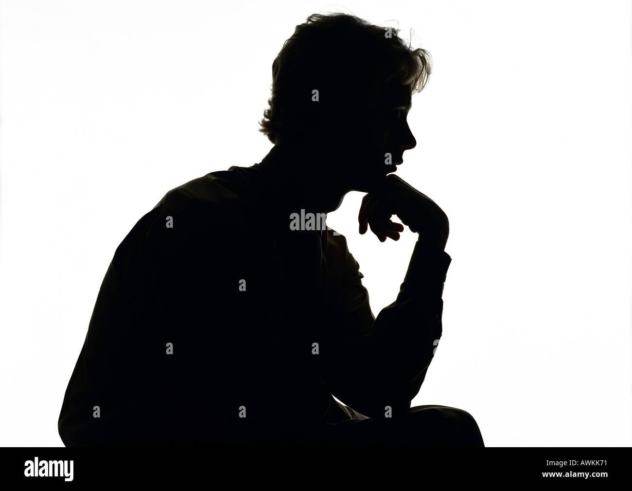 Man thinking, silhouette. - Stock Image