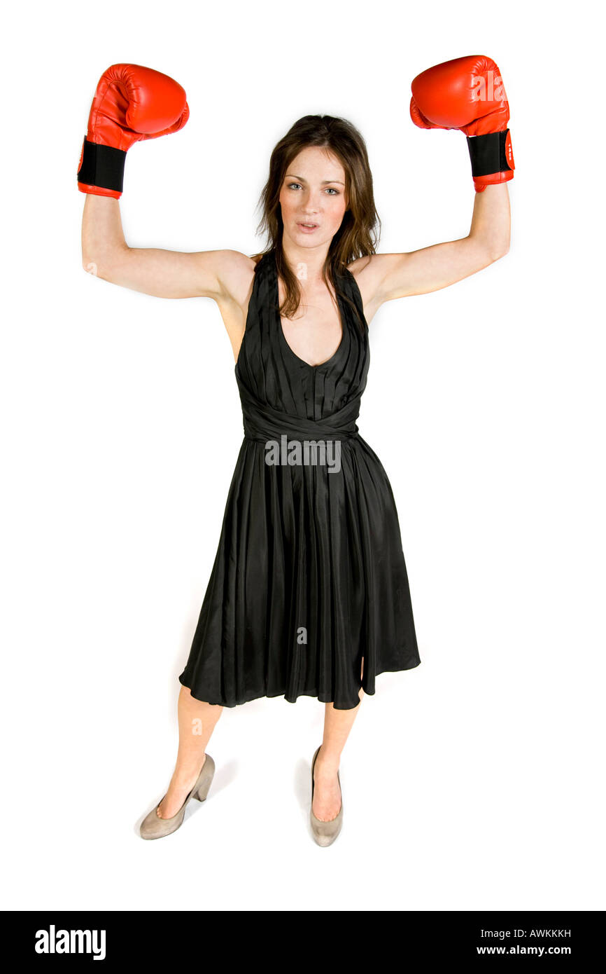 9a7777533 A brunette wearing a black evening dress and boxing gloves Stock ...