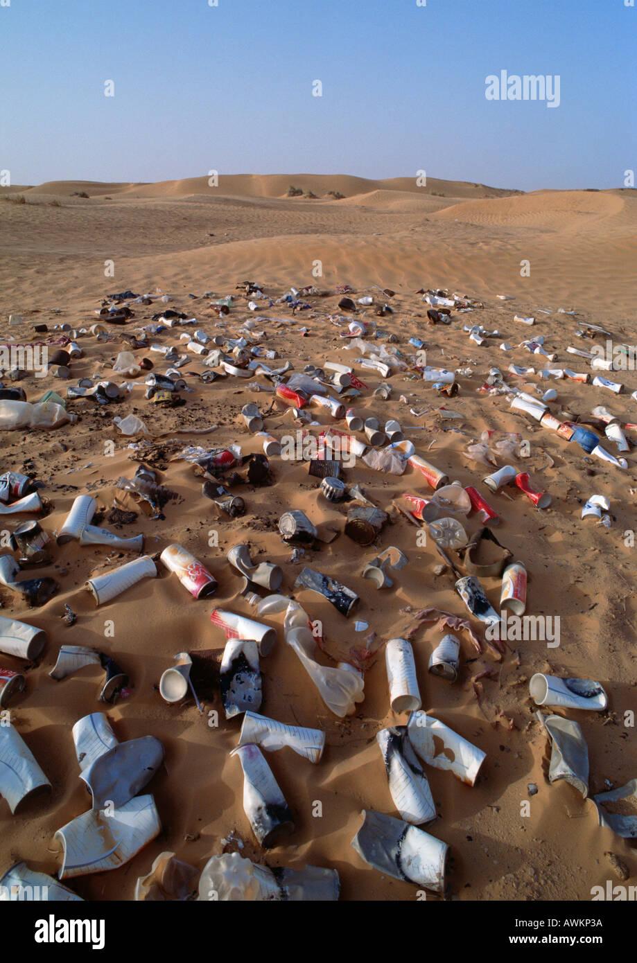 Garbage scattered over desert terrain Stock Photo